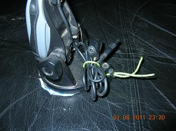 Cord leash bundling power cord, give it a half twist and pull tight to secure to base
